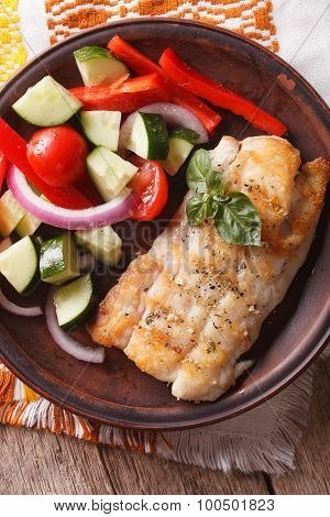 Grilled Fillet Of Fish And Vegetable Salad Close-up. Vertical Top View