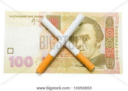 Two Cigarettes Crossed Over One Hundred Hrivna Bill