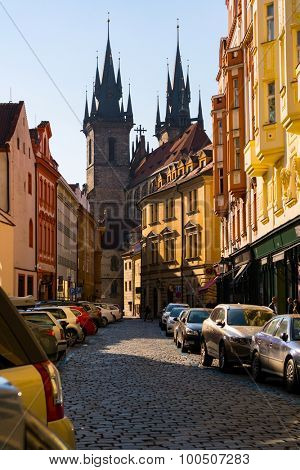 Prague Tyn Cathedral sunset view from old town street, Czech Republic