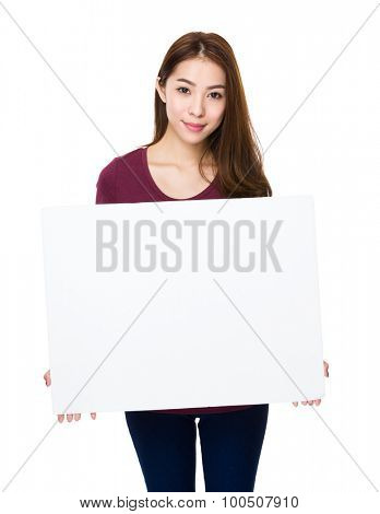 Young woman showing with empty white board