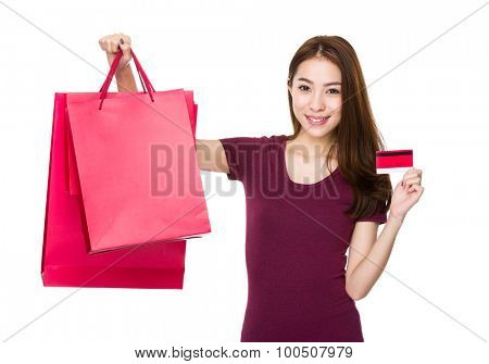 Young woman hold with credit card and shopping bag