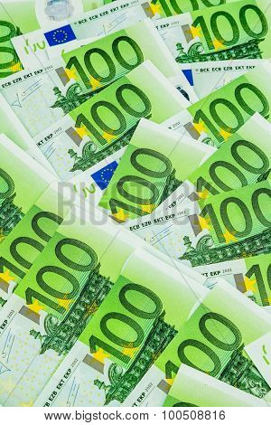 many einhhundert euro banknotes are adjacent. symbolic photo for wealth and investment