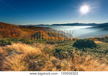 Autumn Mountain Scenery Against Rising Sun