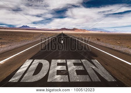 Ideas (in German) written on desert road