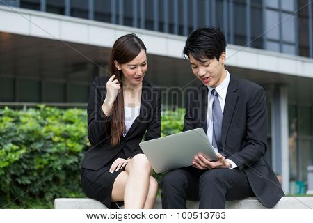 Business people using the laptop computer and working together at outdoor