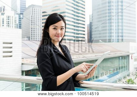Businesswoman using the tablet pc at outdoor