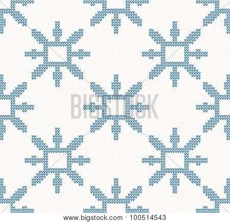 Christmas knitted pattern with blue snowflakes on a white background