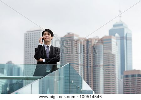 Businessman discuss via cellphone at outdoor