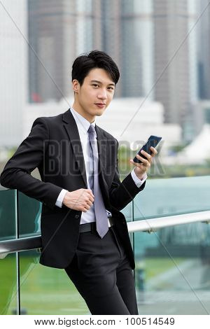 Businessman hold with cellphone at outdoor