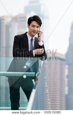 Confident businessman talk to cellphone at outdoor