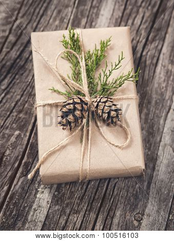 Hand crafted gift on rustic wooden background