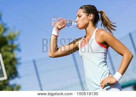 Young Beautiful Athlete Drinking Water After Exercising
