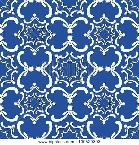 Ornamental Seamless Pattern. Vintage Template. White Curve Elements On The Blue Background.