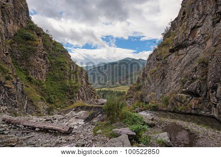 Mountain River Flowing Along Little Canyon