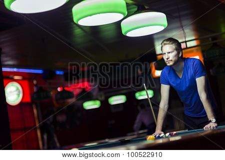 Handsome Young Snooker Player Bending Over The Table
