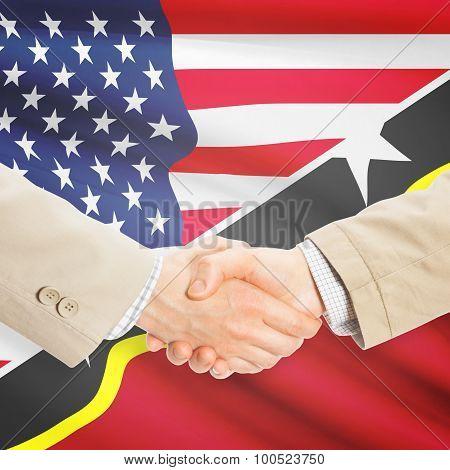 Businessmen Handshake - United States And Saint Kitts And Nevis
