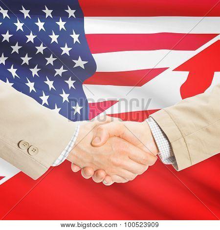 Businessmen Handshake - United States And Tonga