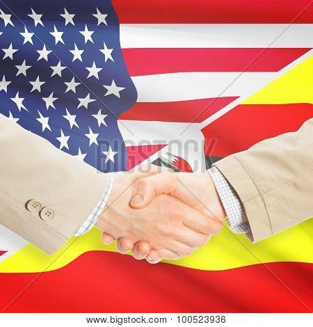 Businessmen Handshake - United States And Uganda