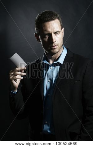 Unshaven Man With Card