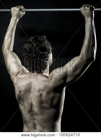 Muscular Man Doing Chin-ups