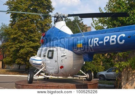 KIEV, UKRAINE - SEP 2, 2015:  The monument of helicopter Mi-2 (Codling) near  near Technical History Museum  of National Polytechnic University on September 2, 2015 in Kiev, Ukraine