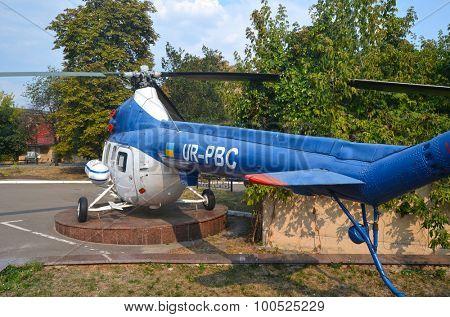KIEV, UKRAINE - SEP 2, 2015:  The monument of helicopter Mi-2 (Codling) near  near Technical History Museum  of National Polytechnic University on September 2, 2015 in Kiev, Ukraine