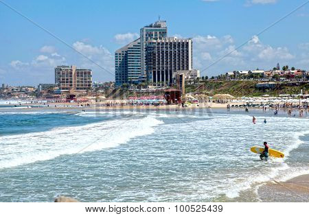 Sand Beach Of The Mediterranean Sea And Modern Hotels In Herzliya, Israel.