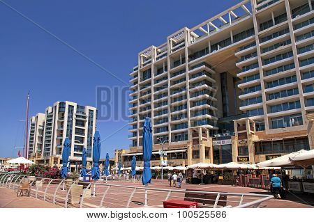 Modern Buildings And Ritz-carlton Hotel On Promenade In Herzliya Marina, Israel.