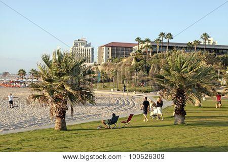 People Relax On The Beach In Herzliya Pituah, Israel.