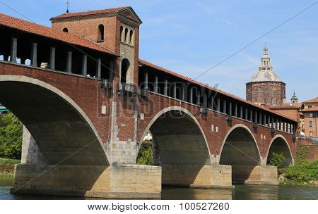 Old Covered Bridge Over The Ticino River In Pavia City In Italy