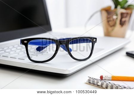 Workspace With Hipster Glasses On Laptop
