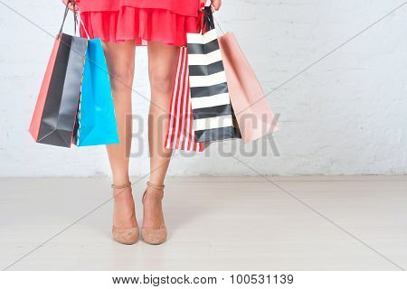 Woman's Legs And  Lot Of  Shopping Bags