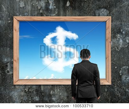 Businessman Looking At Wooden Frame White Dollar Sign Shape Clouds