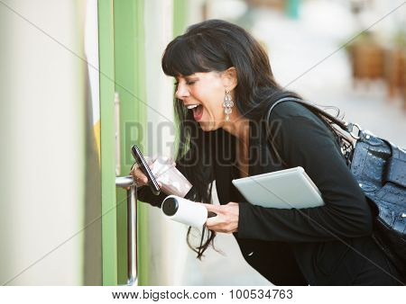Multitasking Woman Opening Door