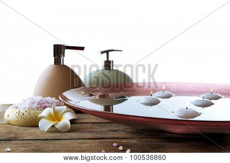 Beautiful spa composition with cosmetic bottles on light background