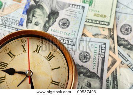 Money and alarm clock, closeup