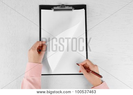 Hands working in the office with documents  on white table