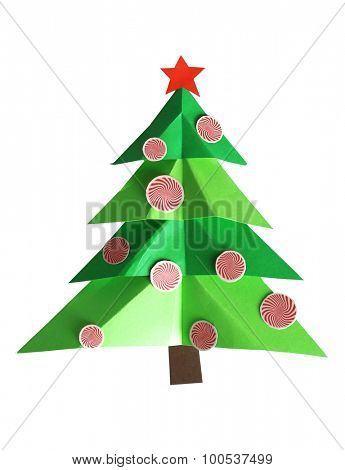 Creative paper Christmas tree on white paper, on wooden background