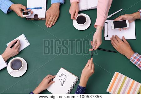 Top view of people hands at working process