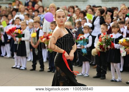 Orel, Russia - September 1, 2015: Girl In Black Dress Dancing Flamenco In School Yard With Pupils