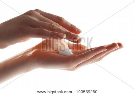 Female hands with cream isolated on white