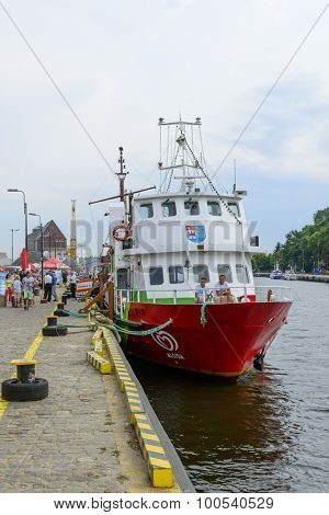KOLOBRZEG - AUGUST 12: Tourist ship waiting in the harbor for tourists taking part in a cruise on the Baltic Sea on 12 August 2015 in Kolobrzeg, Poland.
