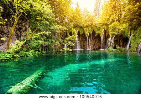 Nature Wonderland, Lake Waterfall In National Park On A Sunny Summer Day With Sunlight. Waterfalls I