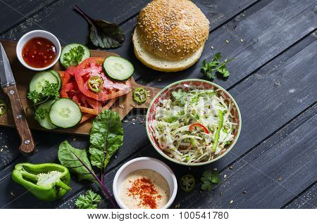 Delicious Veggie Burger. Raw Ingredients - Cabbage, Tomato, Cucumber, Lettuce, Pepper, Sauce Vegetar