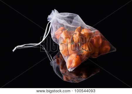 Sack with yellow peppers