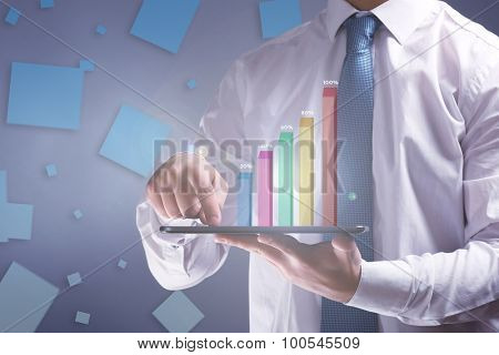 Man touching screen tablet on grey background
