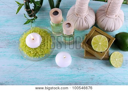 Beautiful composition of spa treatment on color background
