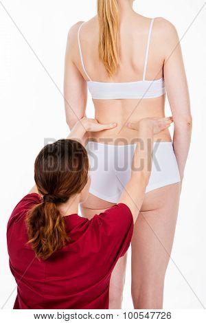 Physiotherapist Doing Back Evaluation