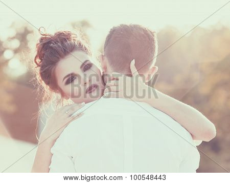 Warm embrace. Girl hugging her boyfriend. Vintage toning