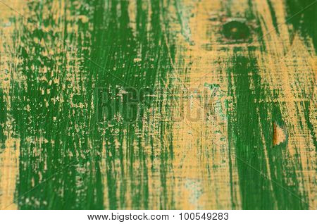 Paint-peeled green coating.